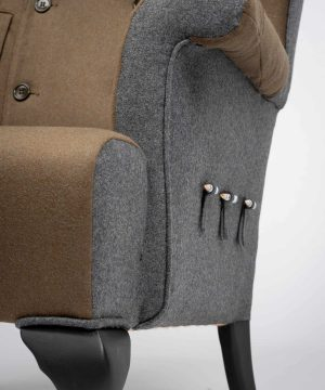 Fine detailed wingchair upholstered with an original Italian Military Uniform