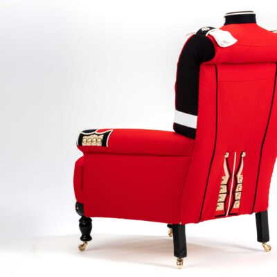 Uniquely detailed armchairs upholstered from original Irish Guard Tunic uniforms