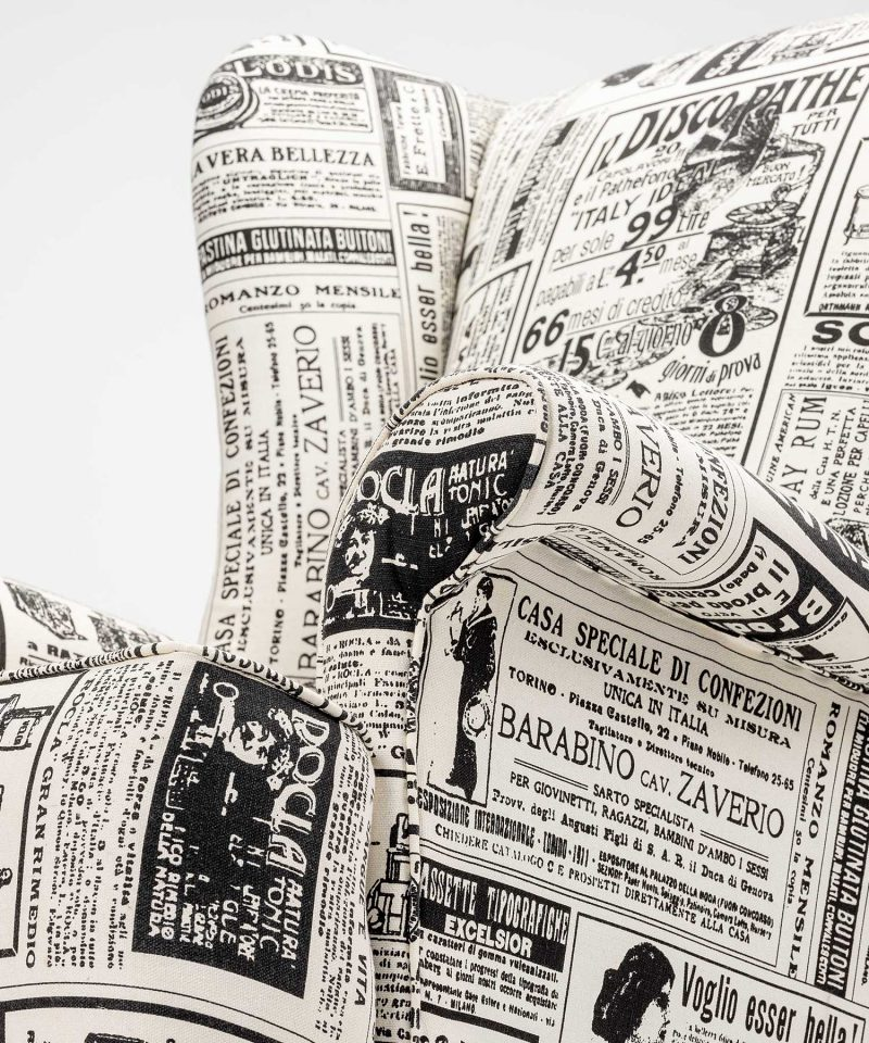 Quirky fireside wing chair vintage newspaper print upholstery