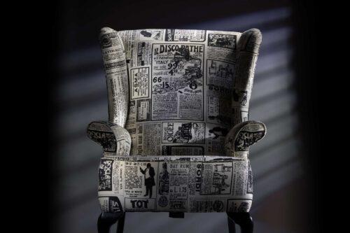 News print upholstered fireside wing chair