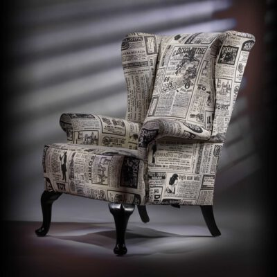 Fireside wing chair upholstered vintage newspaper print