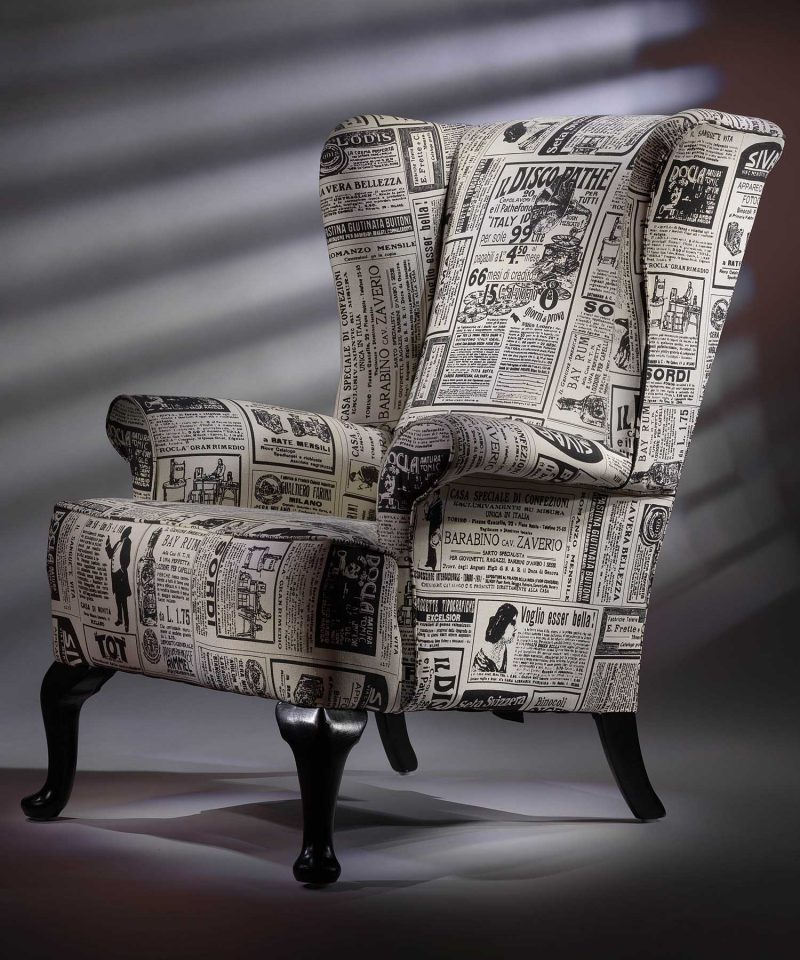 Fireside wing chair upholstered vintage newspaper print
