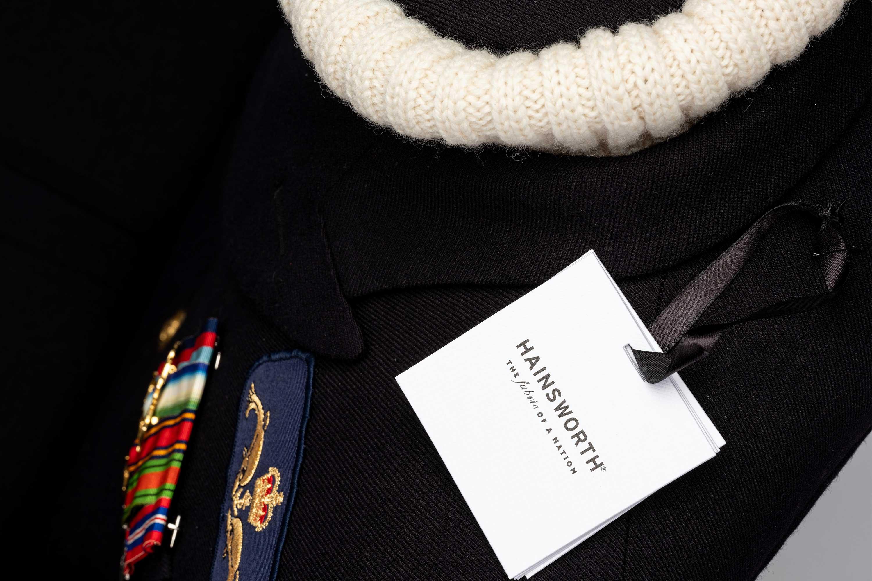 Bespoke submariner naval uniform to chair
