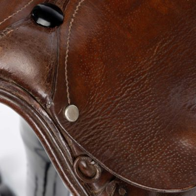 Vintage tan leather saddle bar stool