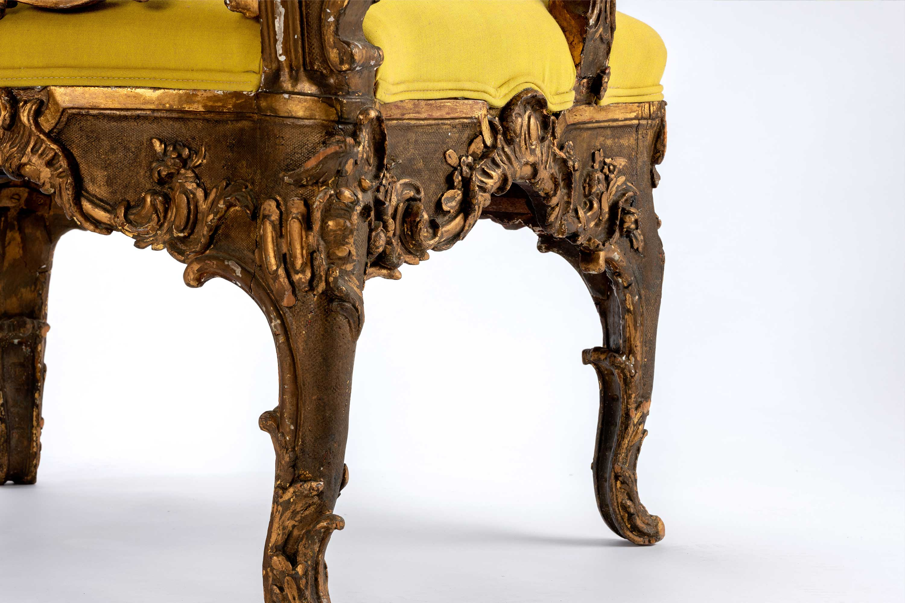 Italian Rococo Intricately Detailed Giltwood Armchair